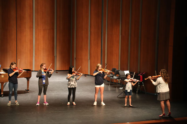 Young string musicians in training Austin Suzuki Institute